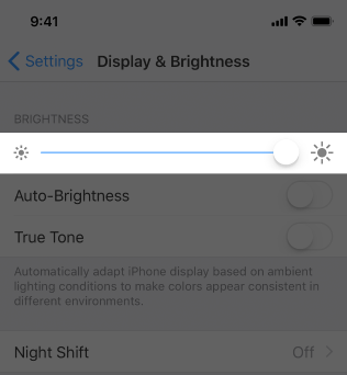 The Brightness slider in Settings > Display & Brightness.